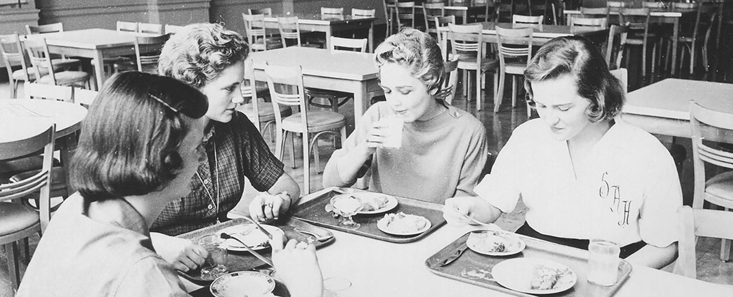 Maryville alums eating lunch in cafeteria during the 70s