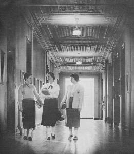 Girls in hall on old campus - from 1953 <em>Promenade</em> yearbook