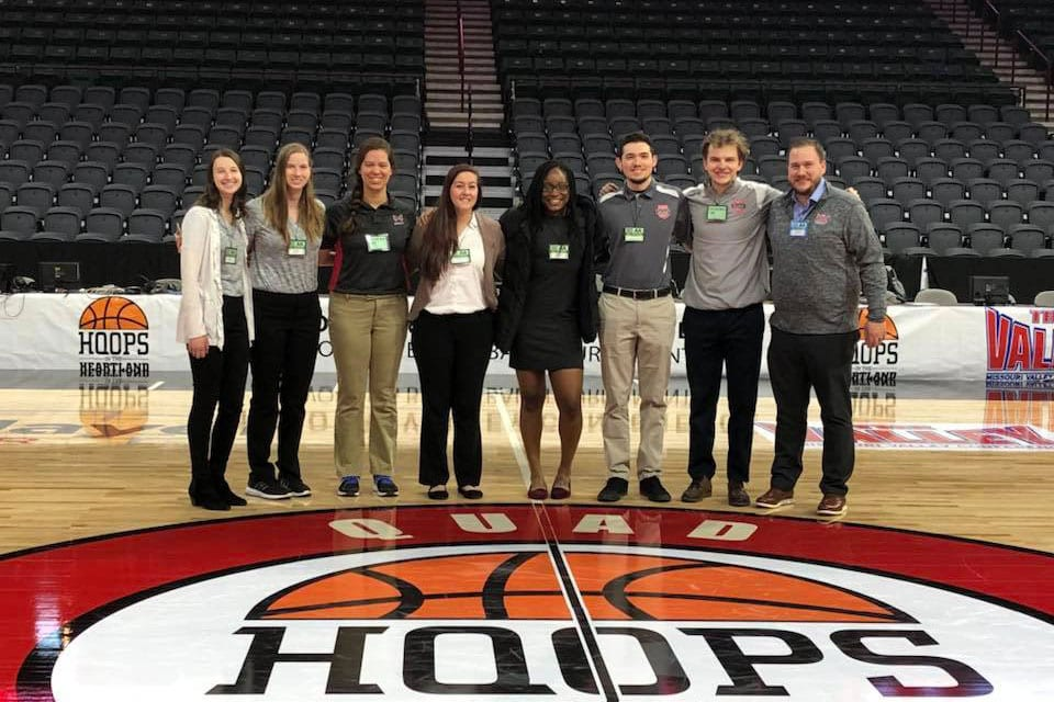 Maryville University Rawlings Sport Management degree students working a the MVC basketball championships