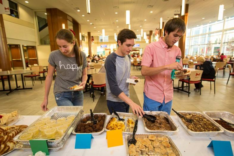 Students take a break to eat during Maccabi games