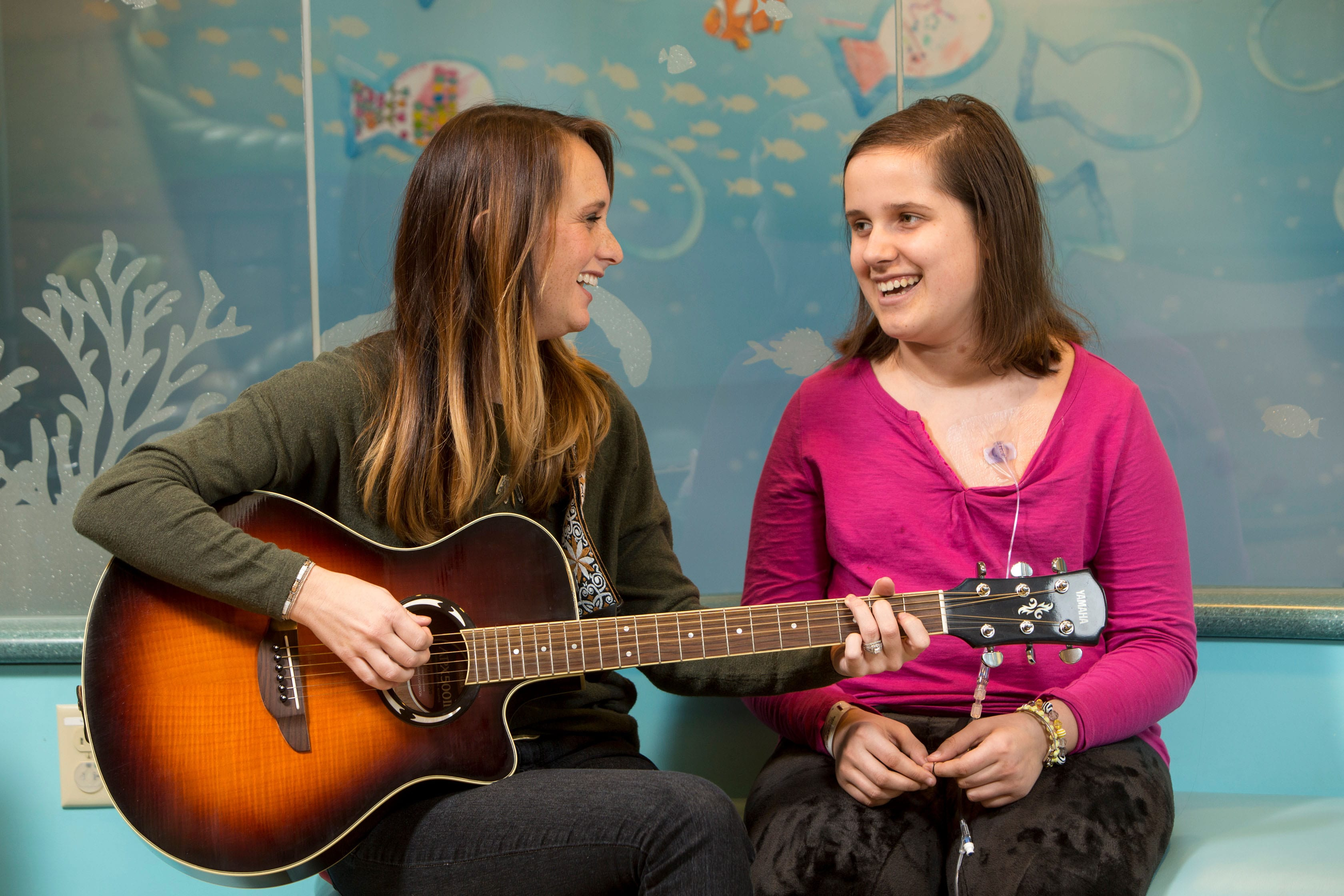 Maryville University music therapy student working with a patient