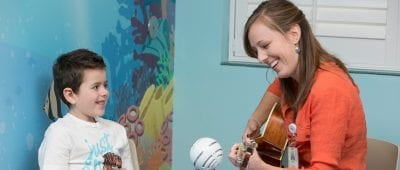 Music therapist Ashley Warmbrod works iwth cancer patients at Cardinal Glennon Children's Hospital as part of the Kids Rock Cancer program.