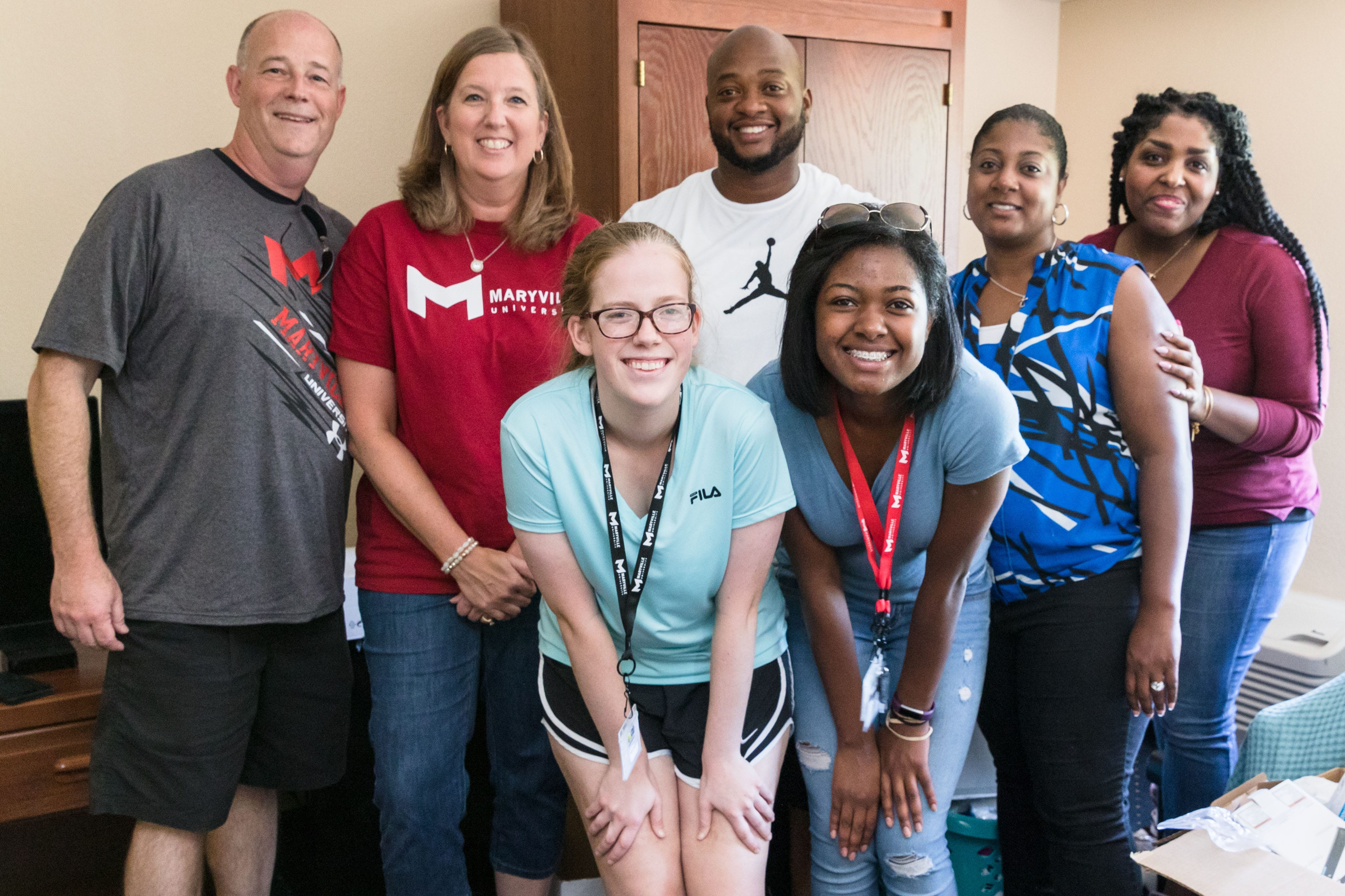 students with family at Maryville University