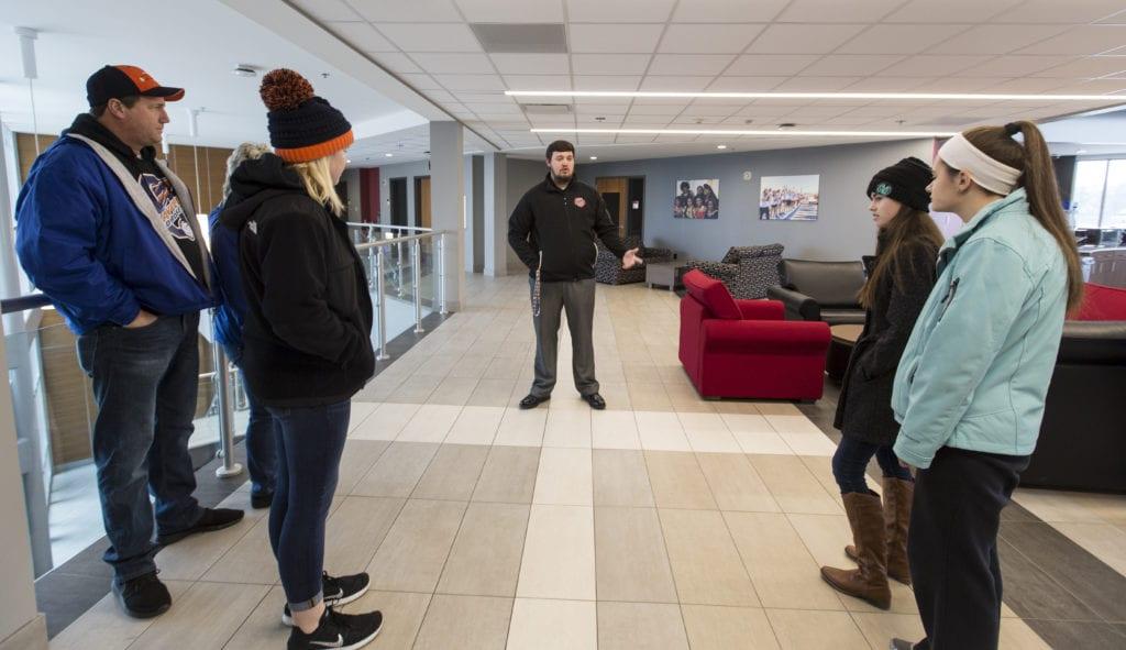 Josh Parrish leads a tour of campus