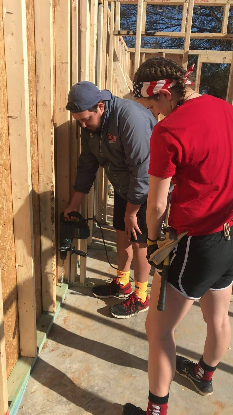 Josh Parrish volunteering with Habitat for Humanity