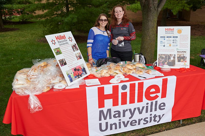 Hillel student at involvement fair