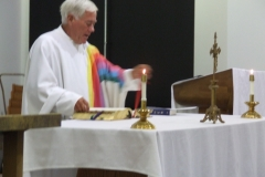 Father Newman offers mass at the Newman Center