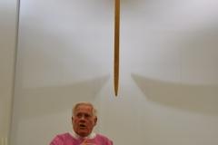 Father Hemanoffers mass at the Newman Center