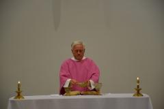 Father Heman offers mass
