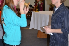 Maryville University student receiving communion during mass at the Newman Center.