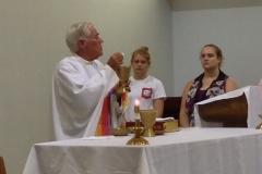 Father Heman offers mass at the Newman Center