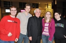 Father Heman and students