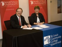 Maryville University President Mark Lombardi, (right) and St. Louis Community College - Florissant Valley President Marcia Pfeiffer