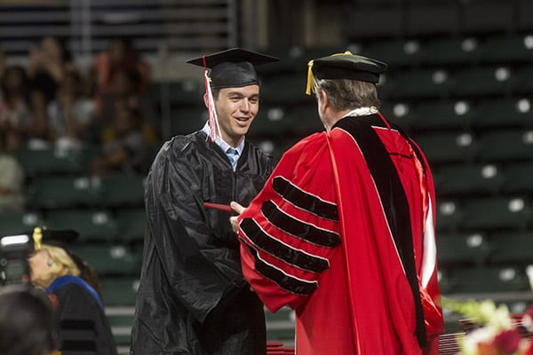 Mark Cohen receiving diploma