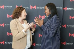 jackie joyner kersee taking interacting  with fans during maryville university leadership event