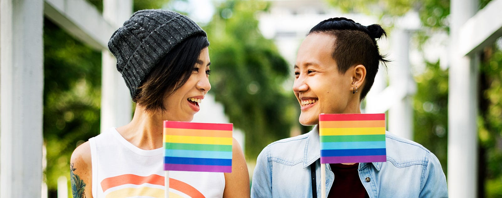 two women holding pride flags