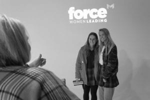 students posing for photo during Women Force event