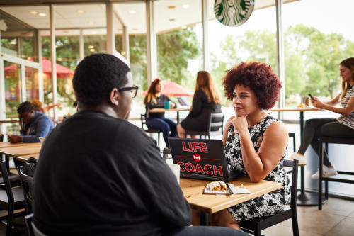 Life coach and student in Starbucks