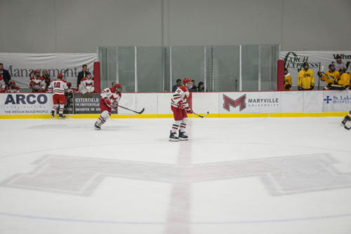 Maryville ice hockey players in a game against Michigan.