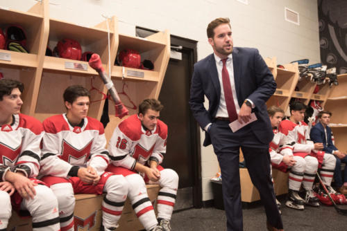 Maryville's ice hockey coach giving speech to players before game